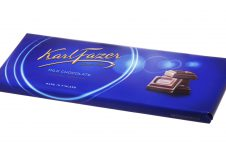 Stockholm, Sweden - November 21, 2013: A blue package with 200 g Karl Fazer milk chocolate bar isolated on white background. Made in Finland, sold on the Swedish market.